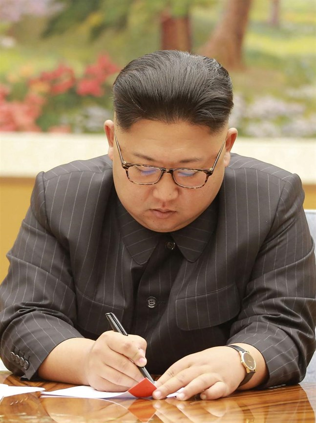 """LKS 20170904 This picture taken on September 3, 2017 and released by North Korea's official Korean Central News Agency (KCNA) on September 4, 2017 shows North Korean leader Kim Jong-Un signing the order sheet of a hydrogen bomb test during a meeting with a committee of the Workers' Party of Korea at an unknown location. North Korea said it detonated a hydrogen bomb designed for a long-range missile on September 3 and called its sixth and most powerful nuclear test a """"perfect success"""", sparking world condemnation and promises of tougher US sanctions. LEHTIKUVA / AFP PHOTO / KCNA VIA KNS / STR / South Korea OUT / REPUBLIC OF KOREA OUT ---EDITORS NOTE--- RESTRICTED TO EDITORIAL USE - MANDATORY CREDIT """"AFP PHOTO / KCNA VIA KNS"""" - NO MARKETING NO ADVERTISING CAMPAIGNS - DISTRIBUTED AS A SERVICE TO CLIENTS THIS PICTURE WAS MADE AVAILABLE BY A THIRD PARTY. AFP CAN NOT INDEPENDENTLY VERIFY THE AUTHENTICITY, LOCATION, DATE AND CONTENT OF THIS IMAGE. THIS PHOTO IS DISTRIBUTED EXACTLY AS RECEIVED BY AFP. / \\Instructions: SEE CAPTION FOR MORE INFORMATION / South Korea OUT / REPUBLIC OF KOREA OUT ---EDITORS NOTE--- RESTRICTED TO EDITORIAL USE - MANDATORY CREDIT """"AFP PHOTO / KCNA VIA KNS"""" - NO MARKETING NO ADVERTISING CAMPAIGNS - DISTRIBUTED AS A SERVICE TO CLIENTS THIS PICTU"""
