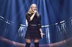 """Rebecka Karlsson framför sitt bidrag """"Who I Am"""" i Melodifestivalens tredje deltävling i Tegera Arena på lördagen."""