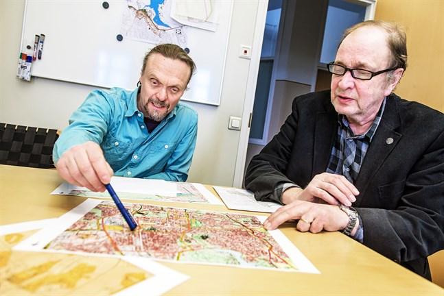 Sören Öhberg och Ilmari Heinonen behöver en ny arbetskamrat för stadsplaneringen.