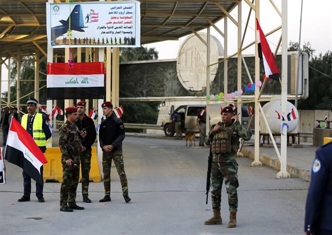 Irakiska säkerhetsstyrkor vid en vägspärr vid den så kallade Gröna zonen i huvudstaden Bagdad.