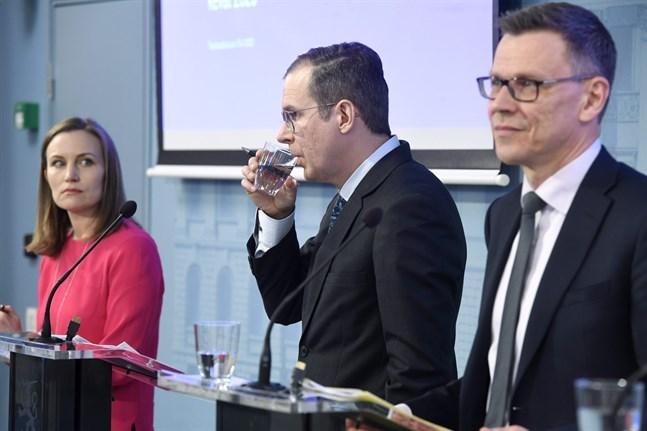 Marja Paavonen, Jukka Railavo and Mikko Spolander during a press conference.