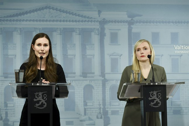 Prime Minister Sanna Marin (L) and Interior Minister Maria Ohisalo during a press conference of the Finnish Government on the coronavirus situation in Helsinki, Finland, on May 4, 2020.