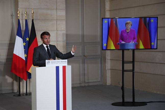 Gemensam presskonferens med Frankrikes president Emmanuel Macron i Paris och Tysklands förbundskansler Angela Merkel – via videolänk från Berlin.