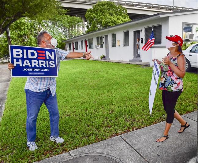 Domenic Sanfana, pensionär som är född i New Jersey av kubanska föräldrar, och Zonia San Martin, som är född i Kuba och arbetar som narkossköterska i Florida, stödjer Demokraternas Joe Biden respektive Republikanernas Donald Trump. Här bråkar de utanför ett av Bidens kampanjmöten i Miami.