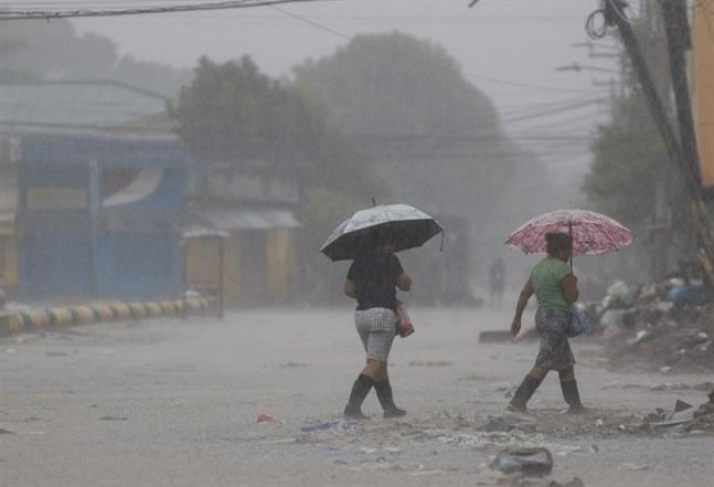 Regn i Iotas spår i La Lima i Honduras tidigare i veckan.