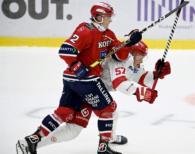 HIFK:s Jere Innala stoppar Sports Emil Johansson.